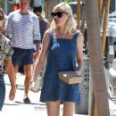 Kirsten Dunst is seen after lunch in a denim dress