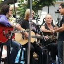 Joe Elliott, Phil Collen and Vivian Campbell of Def Leppard appear for a performance and interview with Mario Lopez of 'Extra' at The Grove, California on June 1st, 2012 - 454 x 330