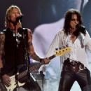 Musician Duff McKagan and singer Alice Cooper of Hollywood Vampires perform onstage during The 58th GRAMMY Awards at Staples Center on February 15, 2016 in Los Angeles, California. - 454 x 325