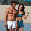 Lucy Watson in Bikini Top and Shorts on the beach in Barbados - 454 x 515