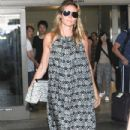 Heidi Klum and her boyfriend touch down at LAX airport in Los Angeles, Califronia on July 31, 2016
