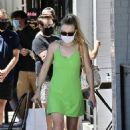 Dakota Fanning – In light green summer dress at Joan's on Third in Studio City
