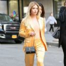 Ashley Benson – Leaving an office building in NYC - 454 x 680