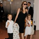 Angelina Jolie and her children arrive at Tokyo International Airport on June 21, 2014