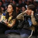 That's one Red Hot smooch! Anthony Kiedis, 52, shares passionate courtside kiss with Brazilian model Wanessa Milhomem, 22, at the LA Lakers game - 454 x 339