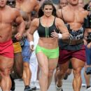 Danica Patrick displays bulky frame to film Super Bowl commercial..... but it's just a muscle suit - 454 x 522