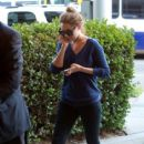 Lauren Conrad arrives at LAX (Los Angeles International Airport) and stays busy making multiple phone calls on two cellphones