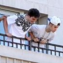 Spitting: Justin Bieber was pictured hurling saliva over a sea of waiting fans from his hotel balcony in Toronto  sPITTING ON FANS