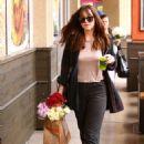 Dakota Johnson – Leaving Erewhon grocery store in Los Angeles