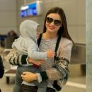 Miranda Kerr and her baby-boy Flynn Bloom arrive at LAX (Los Angeles International Airport)February 28,2012