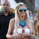 Paris Hilton seen posing for photgraphers at the Coachella festival on Saturday