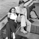 Dolores del Rio and Orson Welles  sail to Catalina Island off the coast of California circa 1940 - 454 x 591