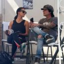 Rocker Tommy Lee and his fiance Sofia Toufa stop by a car wash in Calabasas, California on May 12, 2016. Tommy sat by himself and sent some text messages before returning to Sofia's side - 454 x 504