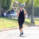 Reese Witherspoon in Tights out jogging in Los Angeles - 454 x 339