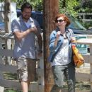 Couple Alyson Hannigan and Alexis Denisof spend some time together at a park in Brentwood, California on July 17, 2015 - 444 x 600