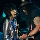Joan Jett and Slash performance together at the 2014 Gibson Brands AP Music Awards at the Rock and Roll Hall of Fame and Museum on July 21, 2014 in Cleveland, Ohio