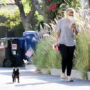 Bebe Rexha – Taking her dog for a walk in Hollywood - 454 x 303