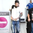 Tommy Lee arrived at the LAX Airport in Los Angeles, California on July 2, 2012 with a few of his buddies