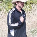 He's an all-rounder! Hugh Jackman plays a game of cricket with family and friends on the beach in Australia