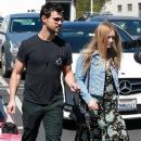 Taylor Lautner and his girlfriend  were seen leaving Fred Segal in West Hollywood, California on March 23, 2017 - 387 x 600
