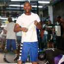 Floyd Mayweather Jr. (L) works out with Nate Jones at the Mayweather Boxing Club on September 2, 2014 in Las Vegas, Nevada - 408 x 594
