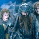 Dominic Monaghan as Merry, John Rhys-Davies as Gimli the dwarf and Billy Boyd as Pippin in New Line's The Lord of The Rings: The Fellowship of The Ring - 2001 - 400 x 276