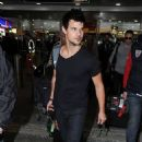 Taylor Lautner Arrives  At Heathrow Airport In London