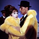 Shirley Maclaine and Robert Mitchum in What a Way to Go!