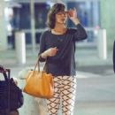 Milla Jovovich Arrives At Jfk Airport In Nyc