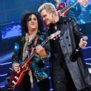 Steve Stevens and Billy Idol perform onstage during the first ever iHeart80s Party at The Forum on February 20, 2016 in Inglewood, California. - 422 x 600