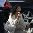 Draya Michele – Enjoys Beignets Delivered by Christina Milian and the Grinch in Los Angeles