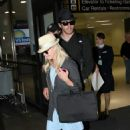 Reese Witherspoon, Jake Gyllenhaal Arrive Together From Paris May 4 2009