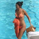 Lucy Mecklenburgh in Orange Bikini at a pool in Beverly Hills - 454 x 641