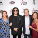 Gene Simmons attends Heroes For Heroes: Los Angeles Police Memorial Foundation Celebrity Poker Tournament at Avalon Hollywood on November 10, 2018 in Los Angeles, California - 454 x 303