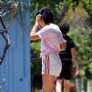 Camila Mendes – Looks sporty while takes her pooch for a stroll in Los Angeles