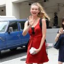 Behati Prinsloo in Red Dress Out in Tokyo