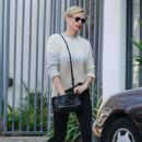 Charlize Theron – Makes a solo trip to a furniture store in Los Angeles