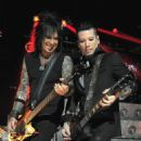 Musicians Nikki Sixx and DJ Ashba of Sixx A.M. perform for iHeartRadio Live at The iHeartRadio Theater Los Angeles on October 7, 2014 in Burbank, California.