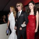 Model Susan Holmes-McKagan, recording artist Duff McKagan and Mae McKagan attend The 58th GRAMMY Awards at Staples Center on February 15, 2016 in Los Angeles, California. - 385 x 600
