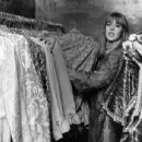 December Jenny Boyd, sister in-law of Beatle George Harrison, helps out at Apple, the Beatles clothes boutique in Baker Street, London - 454 x 346