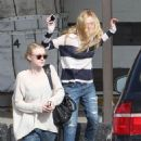 Dakota and Elle Fanning dropped by their local Passport offices in Los Angeles yesterday, March 12.