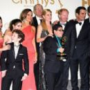 Pictures of the cast of Modern Family, who took home Outstanding Comedy, on stage and in the press room