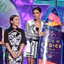 Actress Shay Mitchell attends the Teen Choice Awards 2015 at the USC Galen Center on August 16, 2015 in Los Angeles, California - 454 x 302