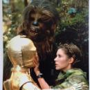 Anthony Daniels as C-3PO, Peter Mayhew as Chewbacca and Carrie Fisher as Princess Leia in