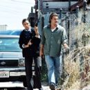 Beth Williamson (Michael Michele) and Bobby Keough (Scott Speedman) search for a suspect