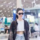 Ming Xi in Jeans Shorts at the Beijing Airport in China - 454 x 681
