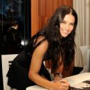 Adriana Lima At Iwc Booth During The Sihh In Geneva