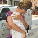 Beyonce Knowles carrying her daughter Blue Ivy Carter in Manhattan (July 18)