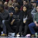 Meek Mill and Nicki Minaj watch the game between the Golden State Warriors and Philadelphia 76ers on January 30, 2016 at the Wells Fargo Center in Philadelphia, Pennsylvania - 454 x 364