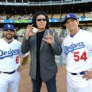 Musician Gene Simmons attends the Dodgers v Mets game to throw out the first pitch of the game at Dodger Stadium with players Aaron Miles and Javy Guerra.on July 5, 2011 in Los Angeles, California.